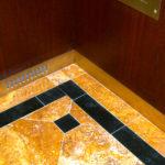 Casellas-Refinishing-Outdoor-building-refinishing-metal-bronze-elevator_1