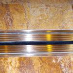 Casellas-Refinishing-Outdoor-building-refinishing-metal-bronze-elevator_2